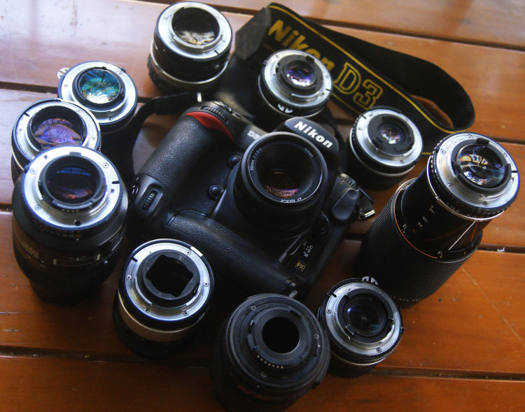 A Nikon DSLR with numerous lenses. (Source image: Bharat Mirchandani / Flickr (CC BY-SA 2.0))